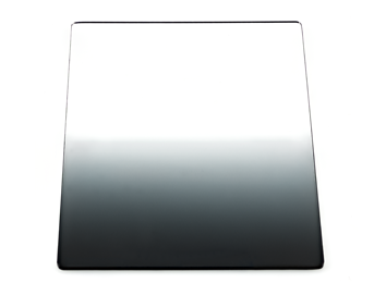 This is a graduated neutral density filter.  Note how the tint starts out lighter, and gradually gets darker as you approach the edge.